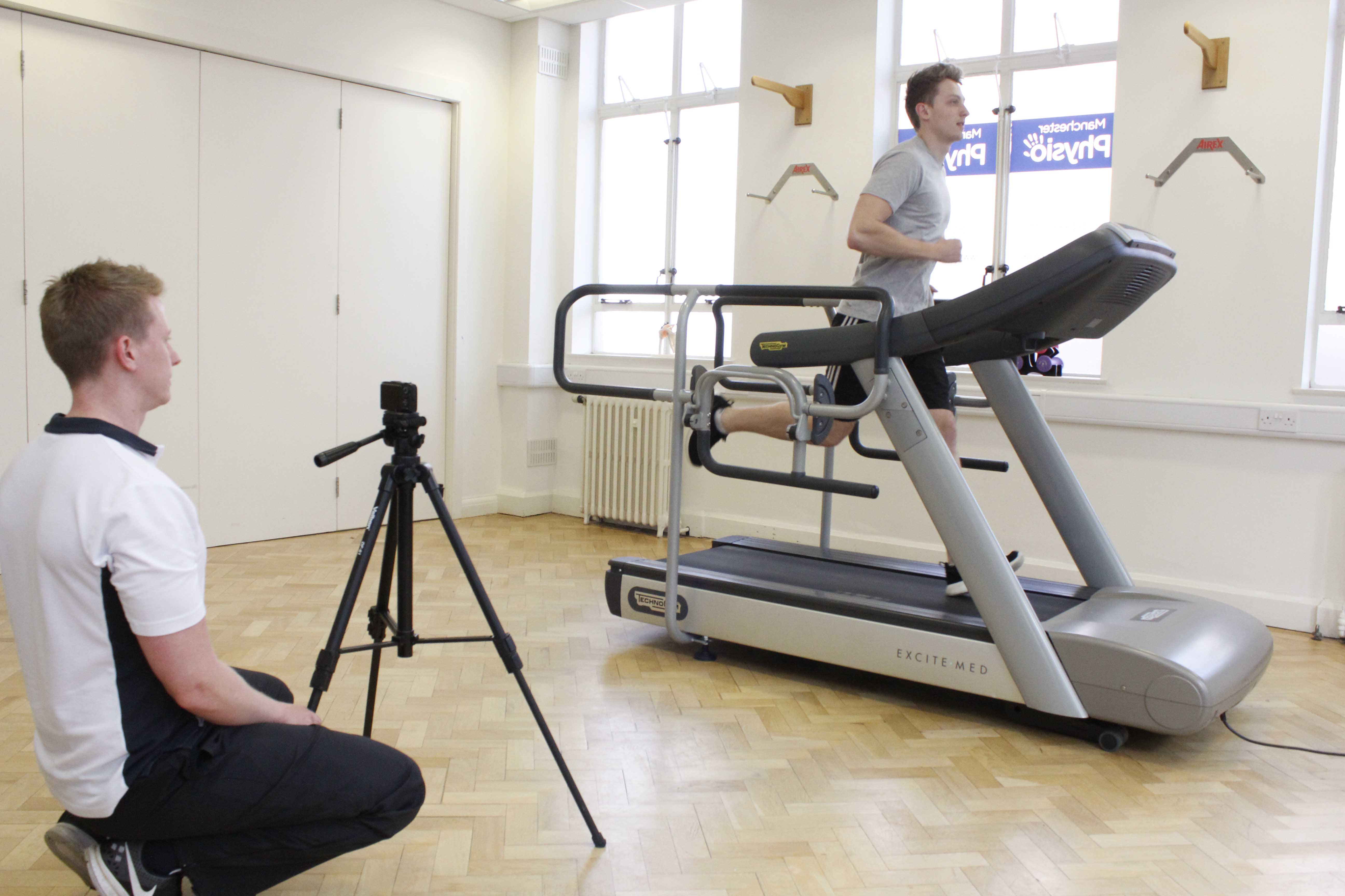 Specilaist physiotherapist conducting a biomechanical assessment of a client's gait pattern