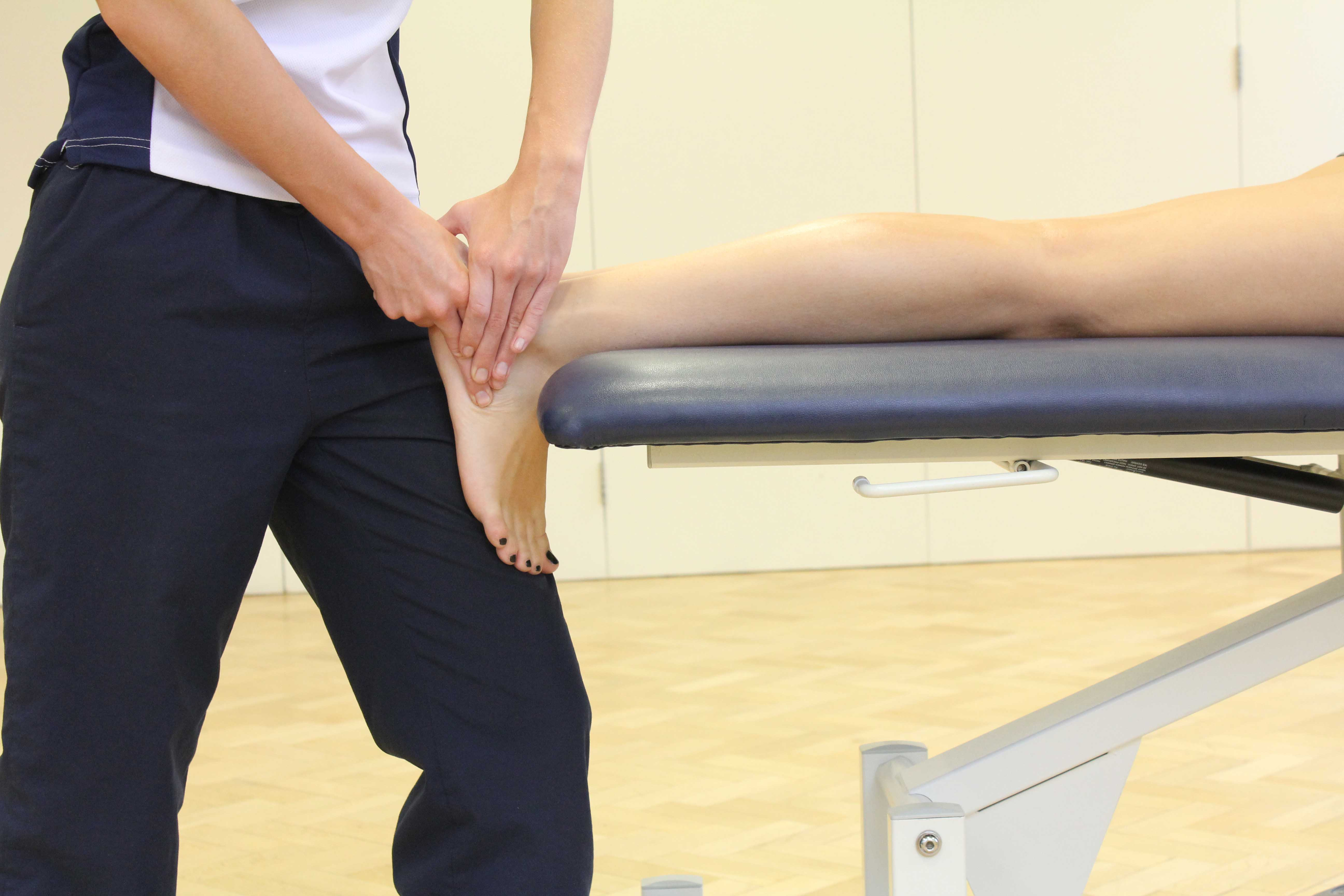 Soft tissue friction massage of the ankle ligaments