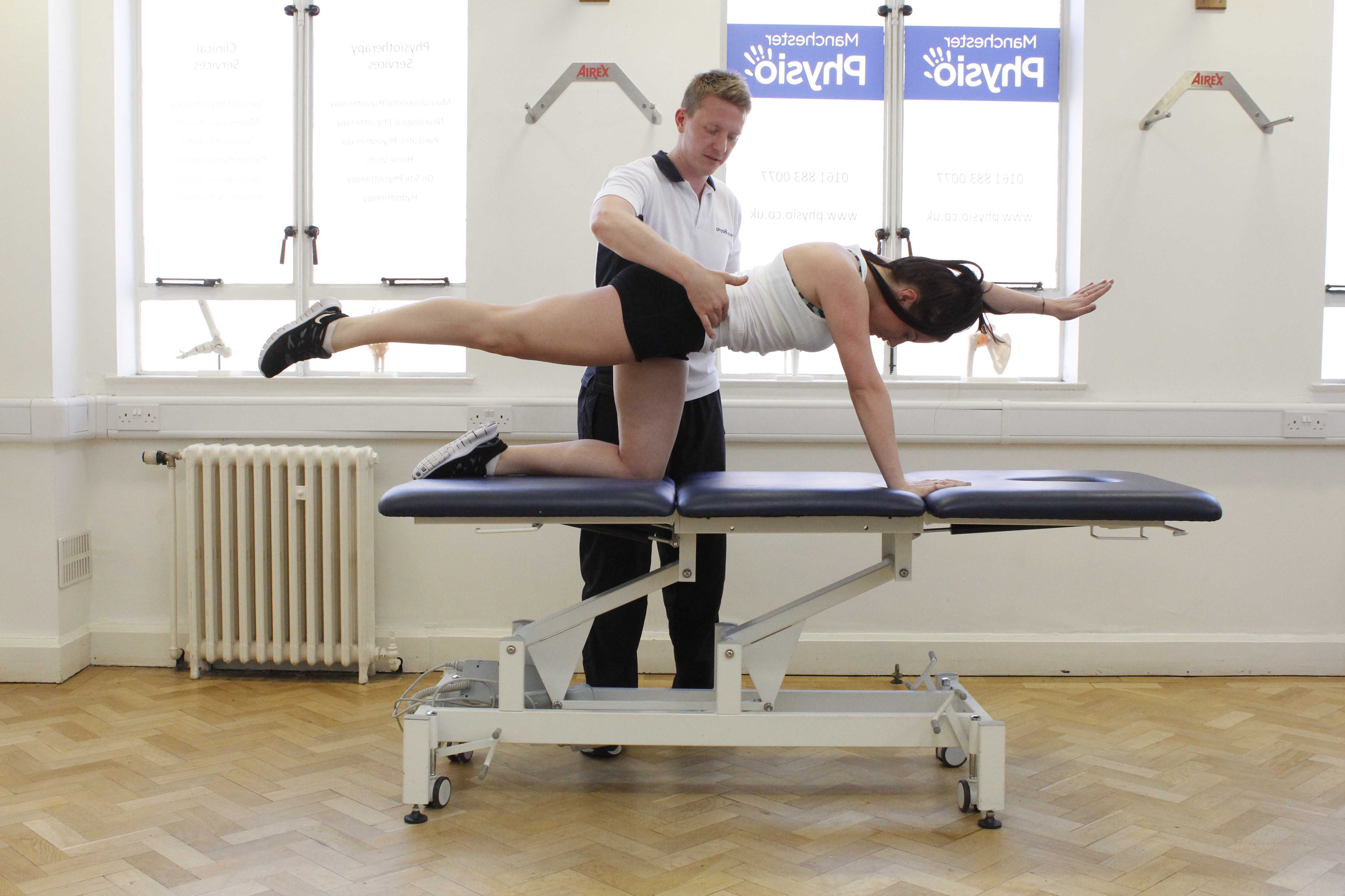 Conditioning exercises for the lower back supervised by experienced therapist