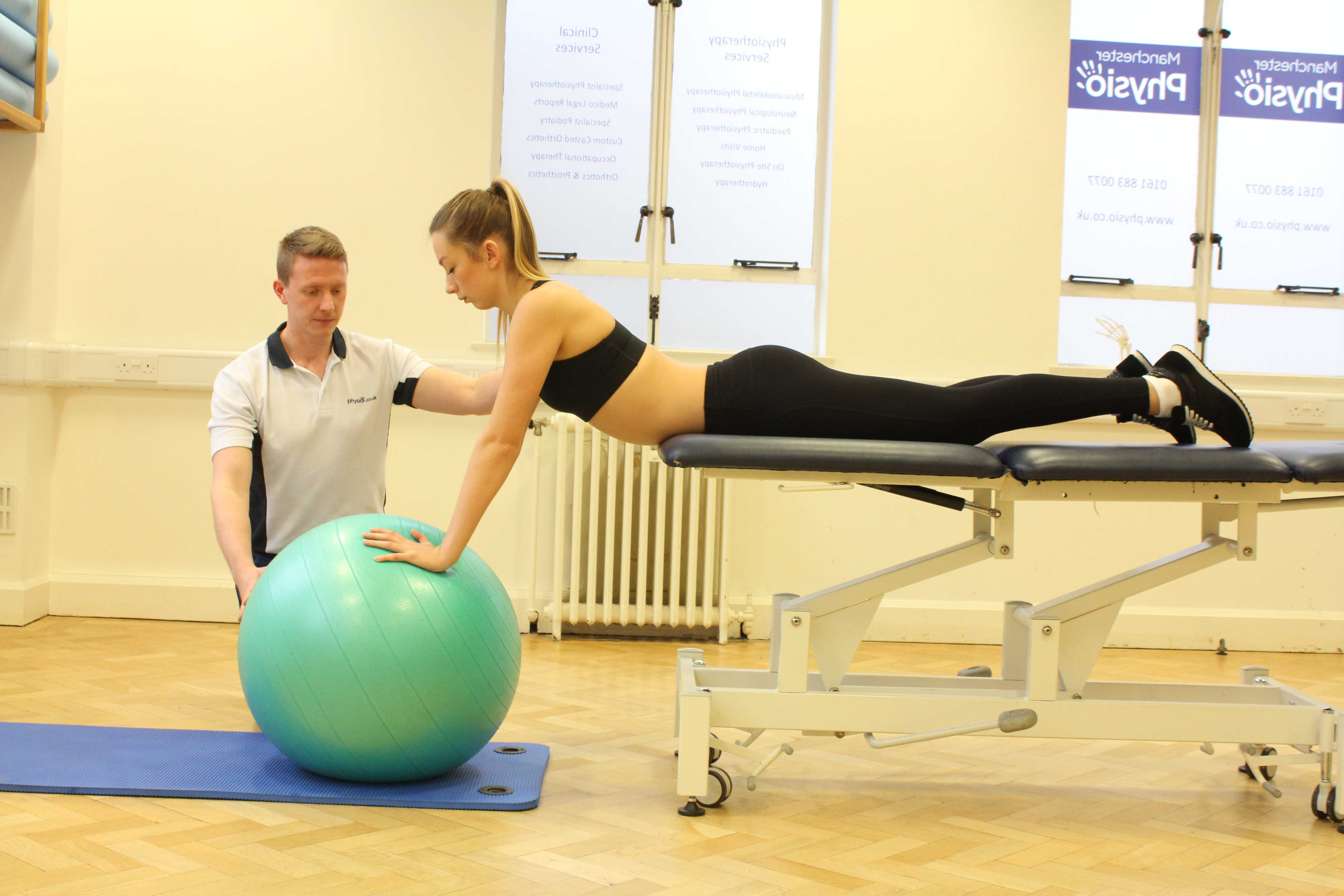 Progressive strengthening exercises for the lower back supervised by an experienced therapist