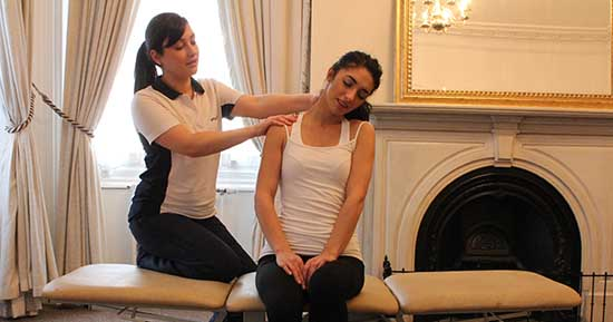 Physiotherapist providing shoulder massage inside rodney street, liverpool