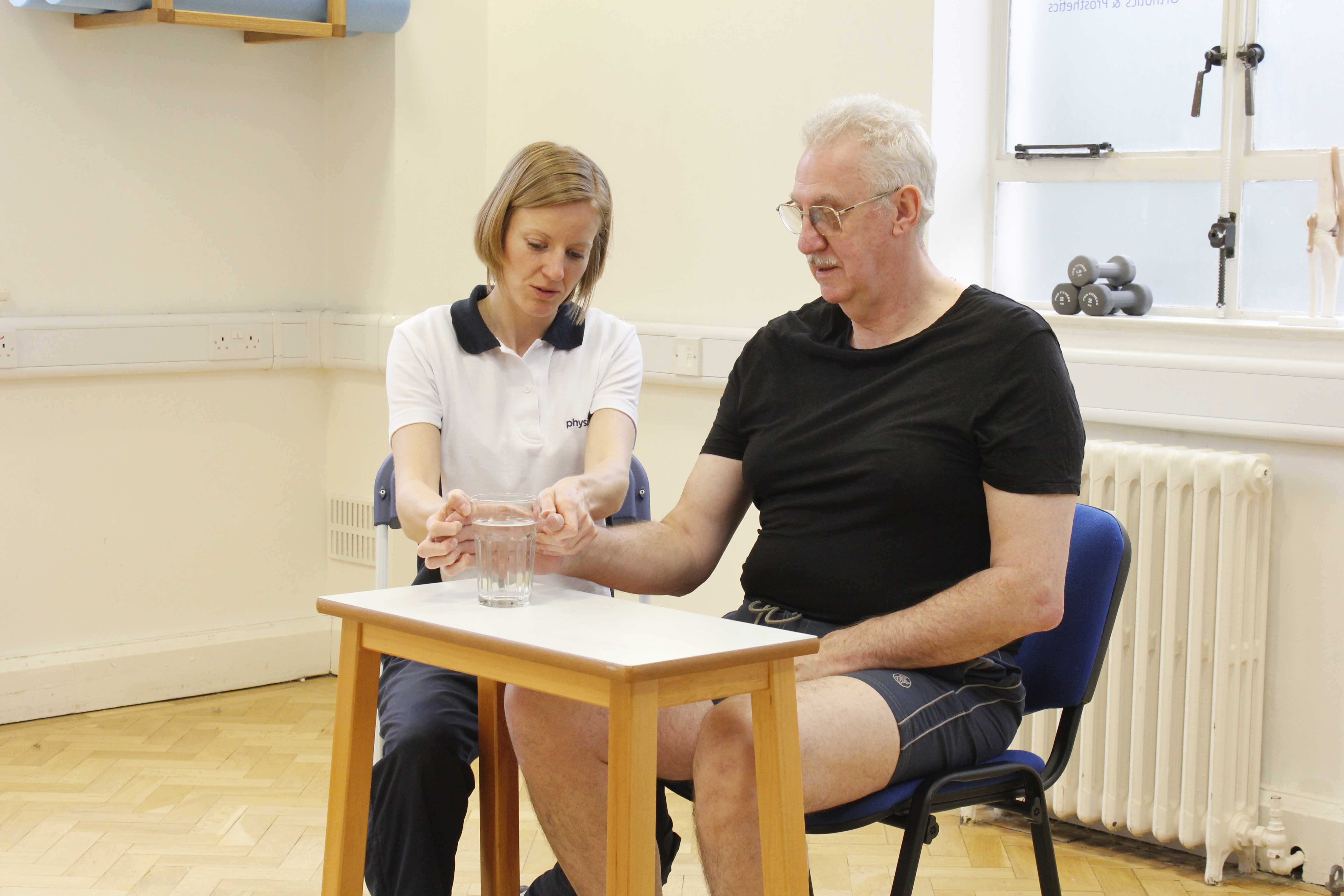 Functional hand exercises assisted by specialist physiotherapist