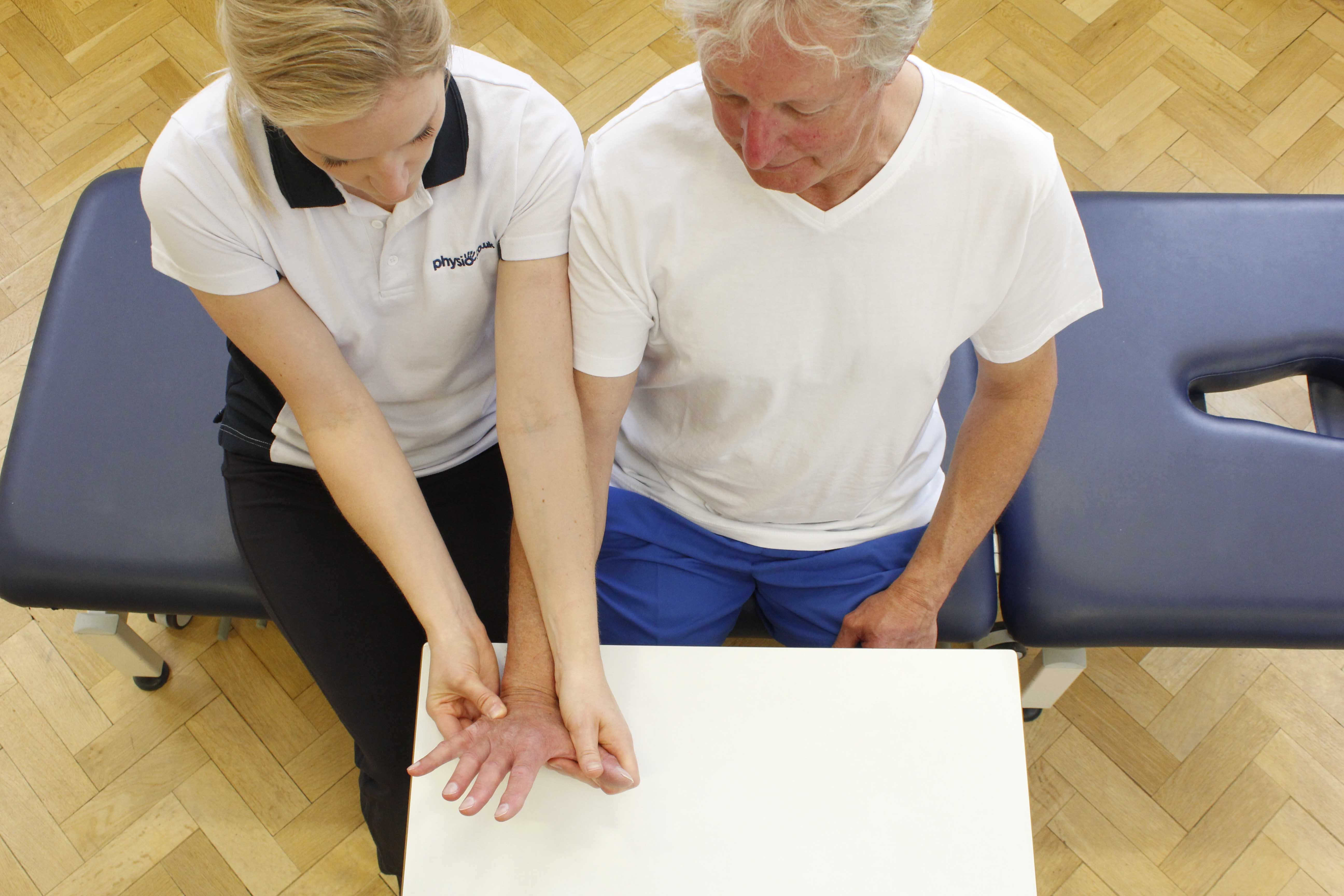 Hand and wrist mobilisations performed by an experienced Physiotherapist