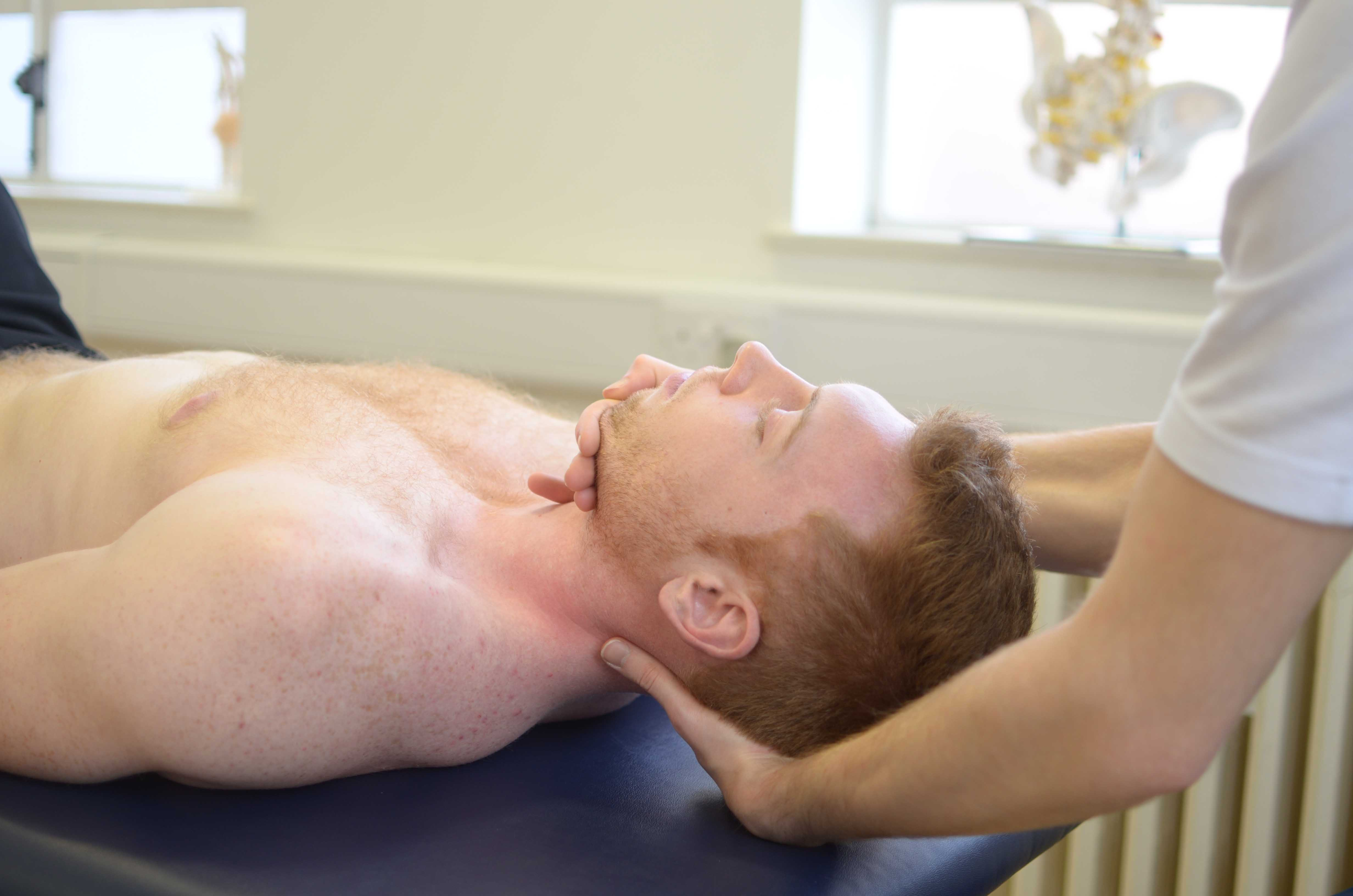 Massage and realignment of the head, jaw and neck to tension and aching