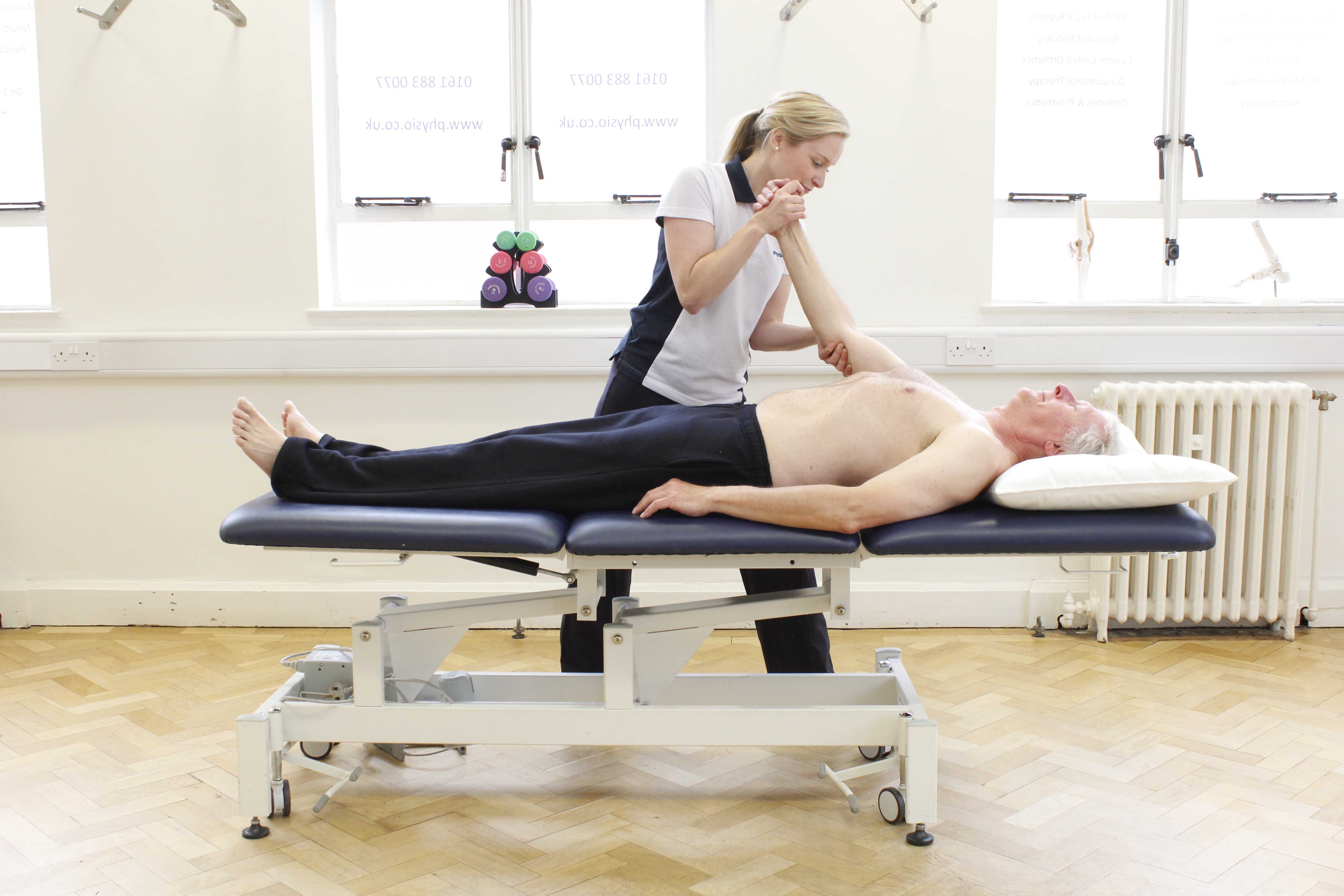 Our physiotherapist helping to decrease any stiffness through gentle upper limb movement.