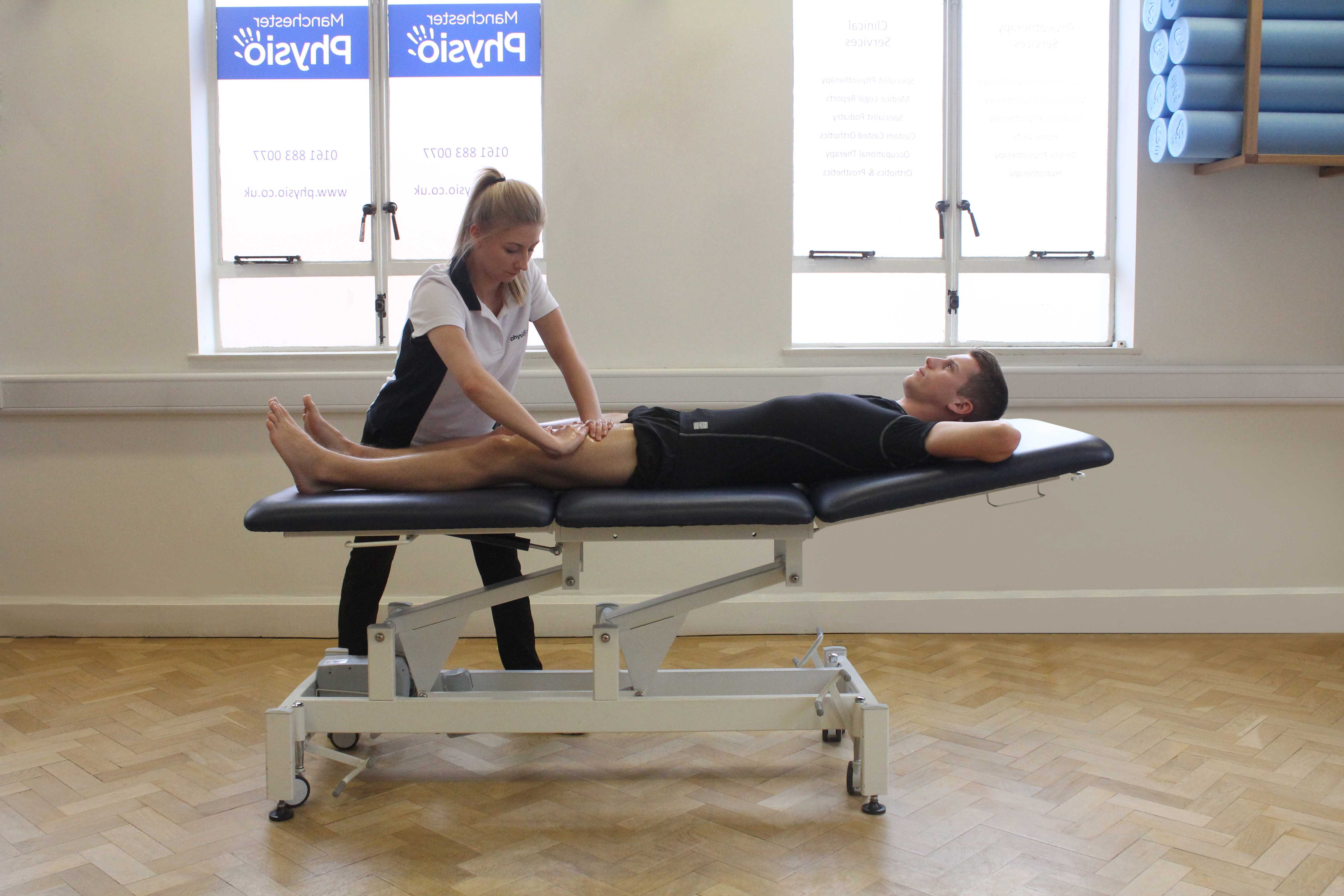 Soft Tissue Massage targeting quadriceps muscle group